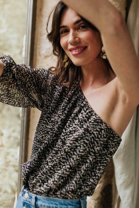 Adeline in a black flower print Skirt