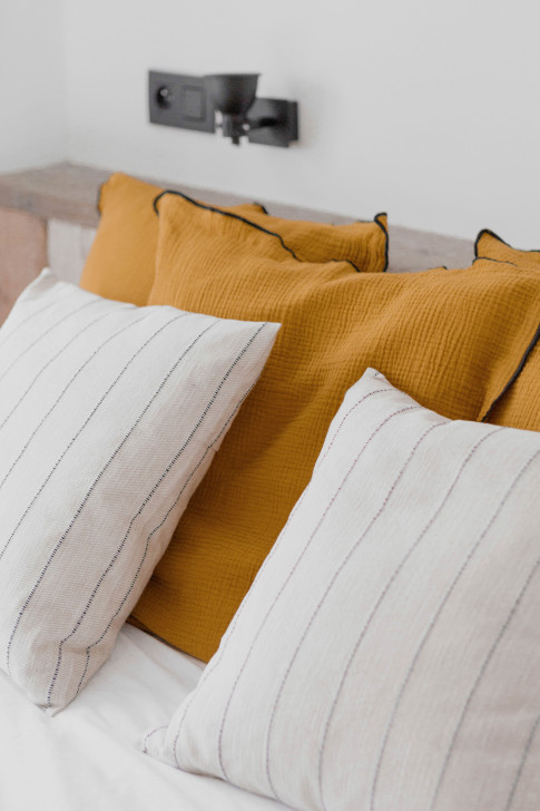 Cushion cover in mustard yellow